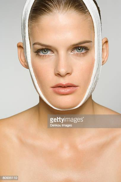 Portrait of a young woman with bandage around her head