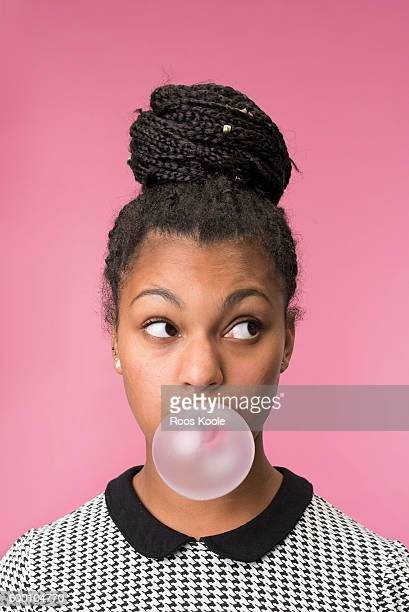 Portrait of a young woman with bubblegum.