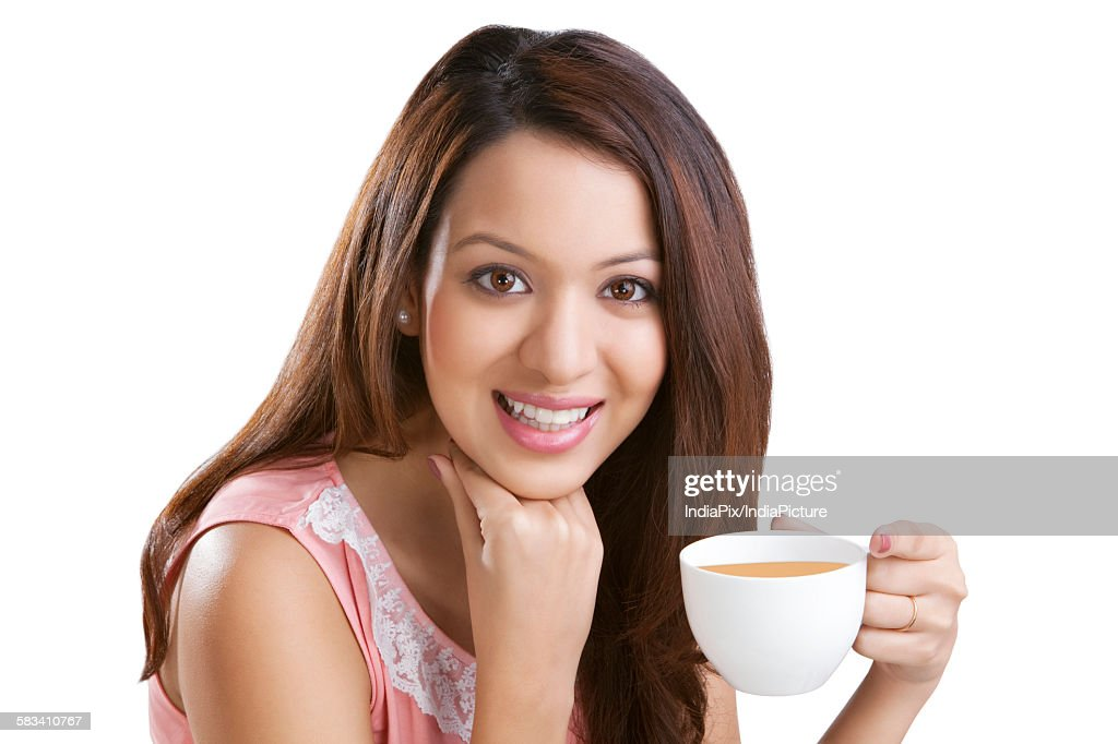 Portrait of a young woman with coffee : Stock Photo