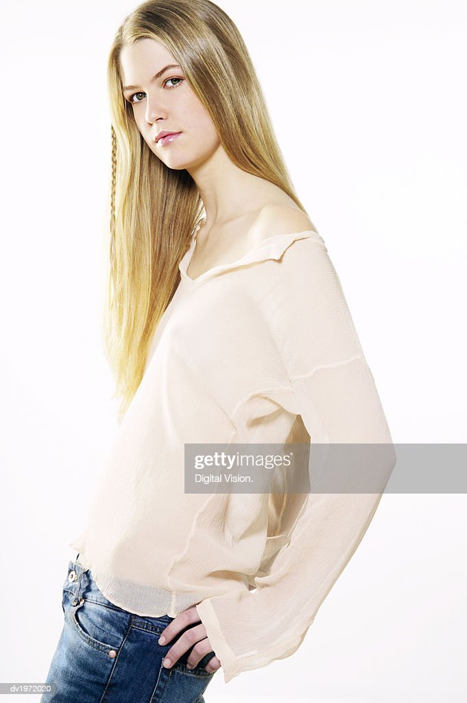 Portrait of a Young Woman With Her Hands on Her Hips : Stock Photo