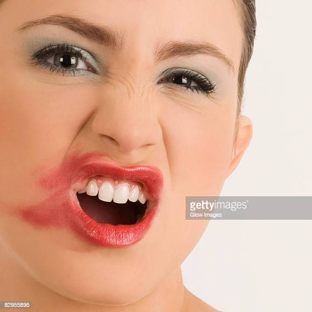 Portrait of a young woman with her messy lips