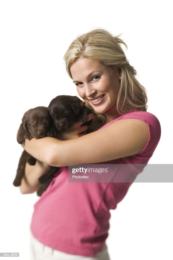 Portrait of a young woman with her puppy : ストックフォト