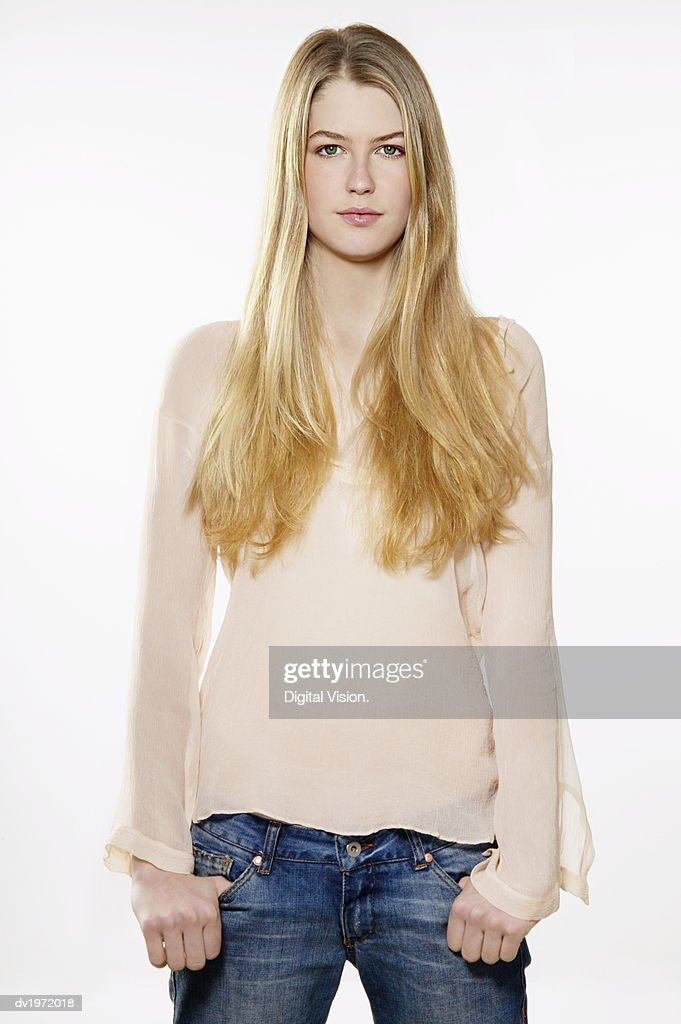 Portrait of a Young Woman with Long Blond Hair : Stock Photo