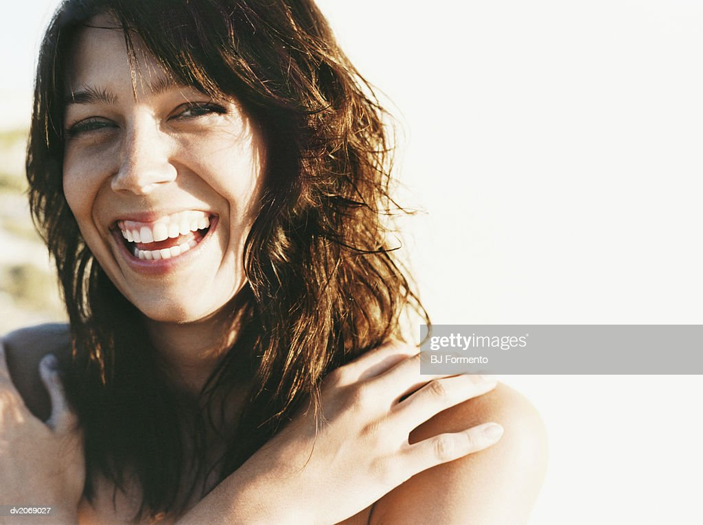 Portrait of a Young Woman With Long Brown Hair Smiling : Stock Photo
