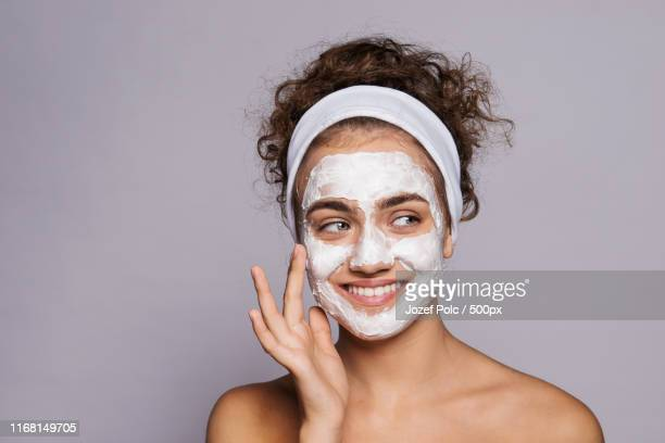 a portrait of a young woman with mask in a studio, beauty and skin care - face mask beauty product stock pictures, royalty-free photos & images