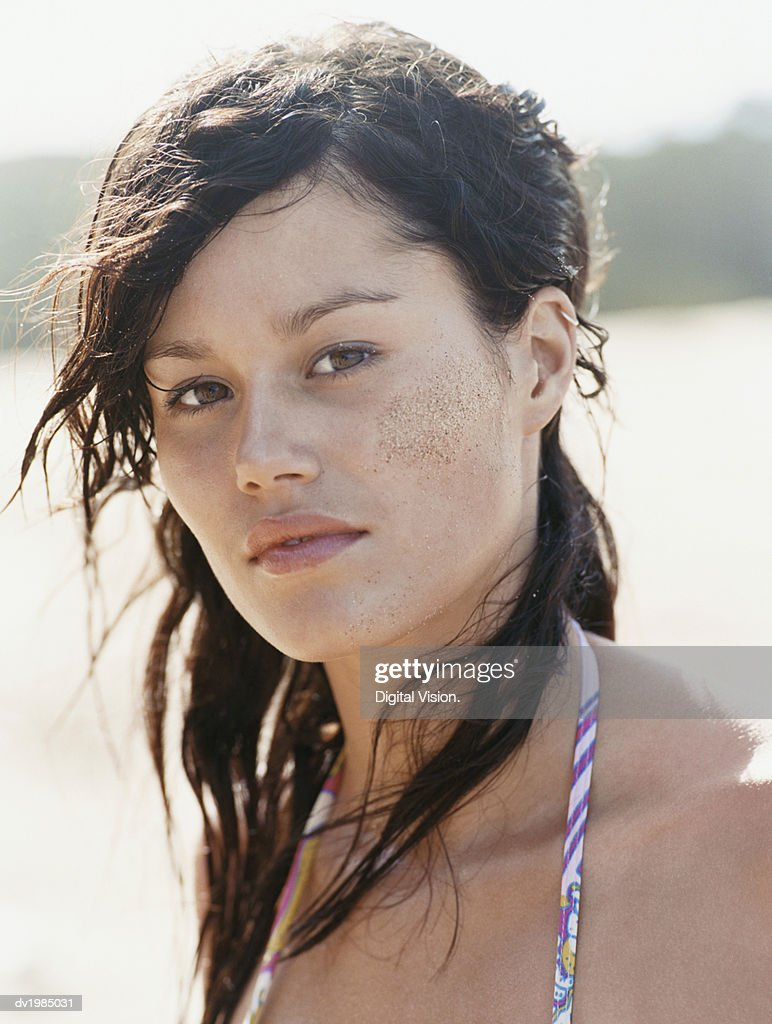 Portrait of a Young Woman With Messy hair and Sand on Her Cheek : Stock Photo
