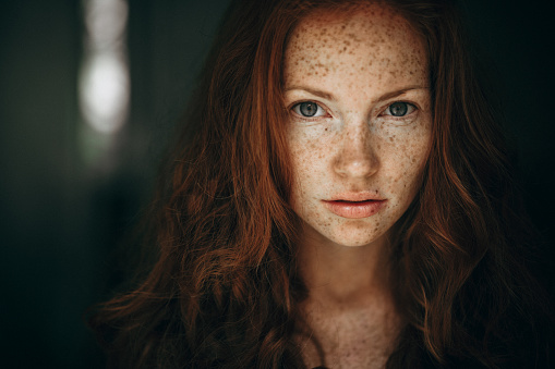 Portrait of a young woman with red hair and freckles. - gettyimageskorea