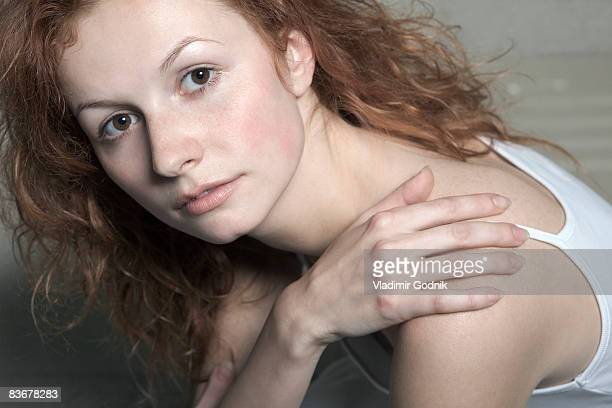 portrait of a young woman with red hair - sleeveless top stock pictures, royalty-free photos & images