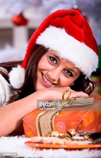 Portrait of a young woman with Santa Claus hat