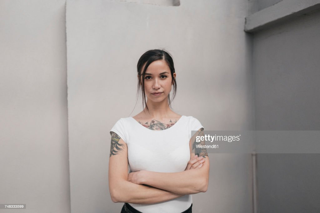 Portrait of a young woman with tattoos : Stock-Foto