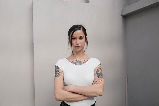 Portrait of a young woman with tattoos - gettyimageskorea
