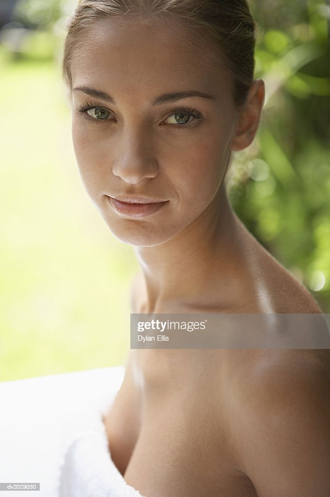 Portrait of a Young Woman Wrapped in a Towel : Stock Photo