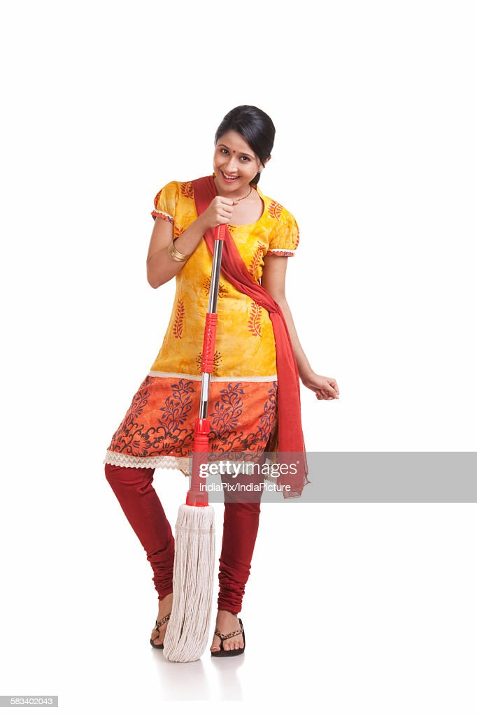 Portrait of a young WOMEN holding a mop : Stock Photo