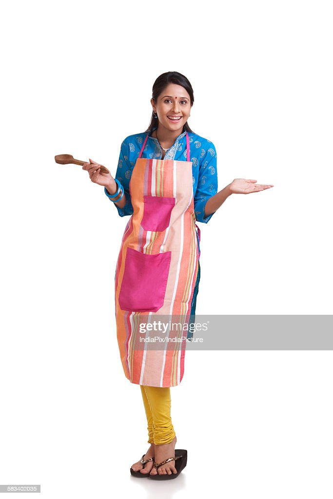 Portrait of a young WOMEN wearing an apron : Stock Photo