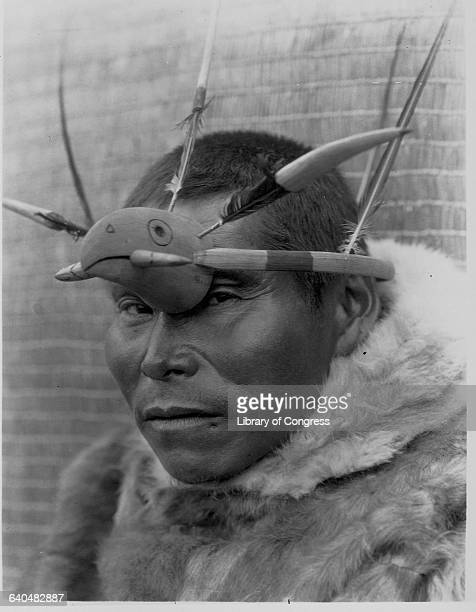 A portrait of a Yupik man wearing an eagleshaped maskette published in Volume XX of The North American Indian by Edward S Curtis | Location Nunivak...