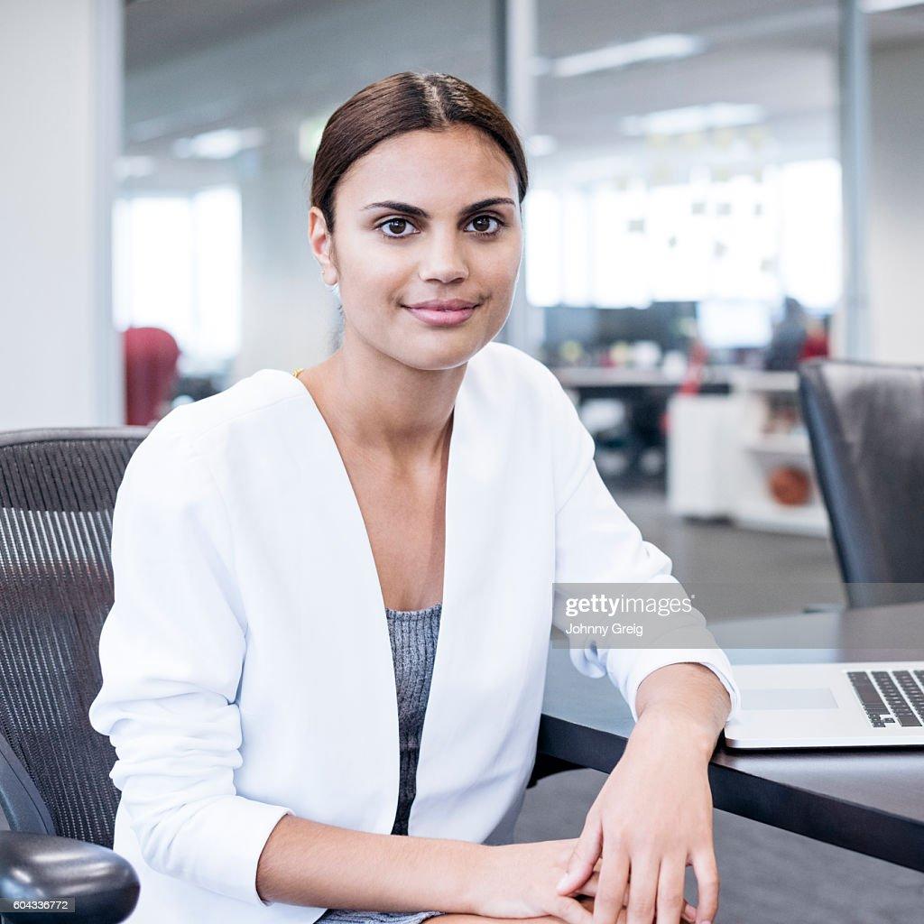 Portrait of Aboriginal Australian woman in office : Stock Photo