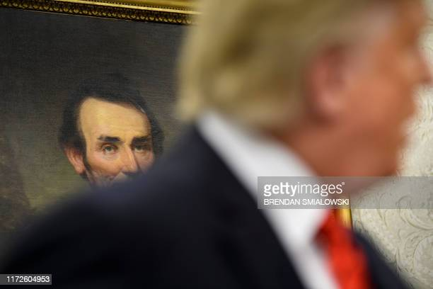 Portrait of Abraham Lincoln is seen while US President Donald Trump speaks during a swearing-in for US Secretary of Labor Eugene Scalia in the Oval...