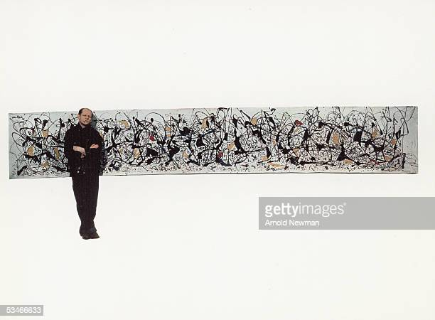 Portrait of abstract expressionist painter Jackson Pollock next to his painting 'Number 9' New York January 3 1949