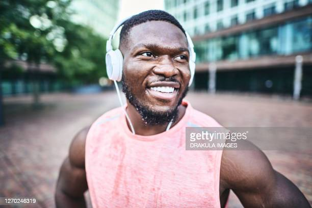 portrait of active african muscular man - scoring run stock pictures, royalty-free photos & images