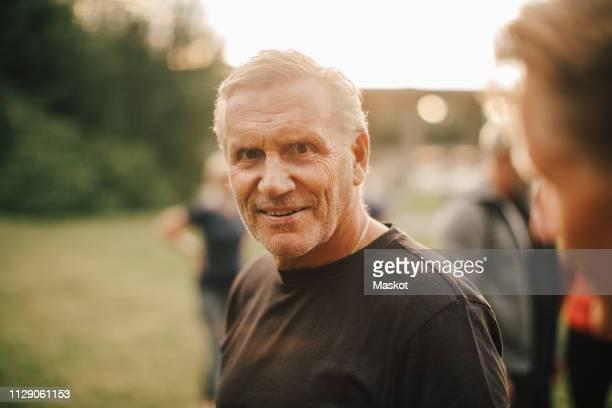 portrait of active senior after workout in park - einzelner senior stock-fotos und bilder