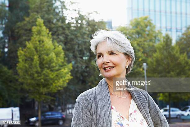 Portrait of active senior woman outside in city