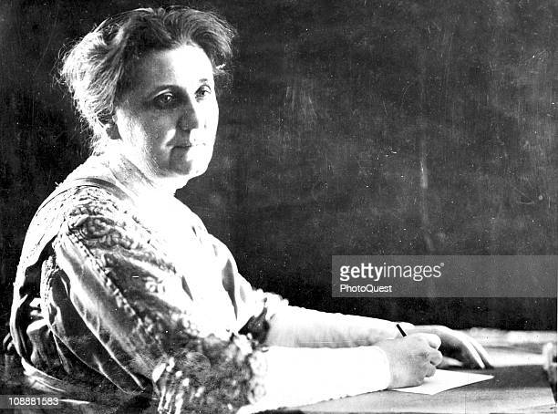 Portrait of activist Jane Addams of Hull House in Chicago at her desk late twentieth century