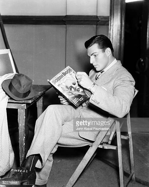 Portrait of actor and athlete Buster Crabbe reading a magazine for Paramount Pictures 1933