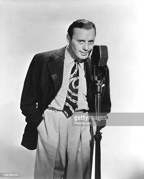 Portrait of actor and comedian Jack Benny standing before a microphone 1940s
