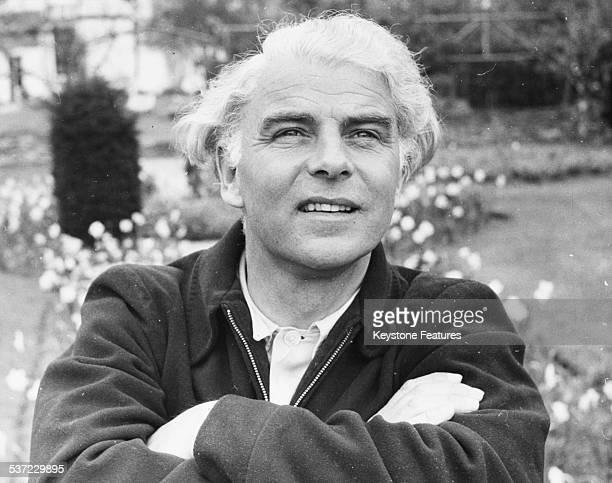 Portrait of actor and dramatist Emlyn Williams in a garden circa 1960