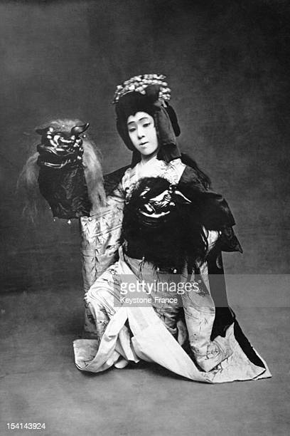 Portrait of actor Baiko Onoe star of the Imperial Theatre of Tokyo famous for his female characterizations pictured as the heroine of the Lion Dance...