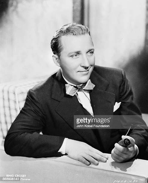Portrait of actor Bing Crosby holding his pipe for Paramount Pictures 1936