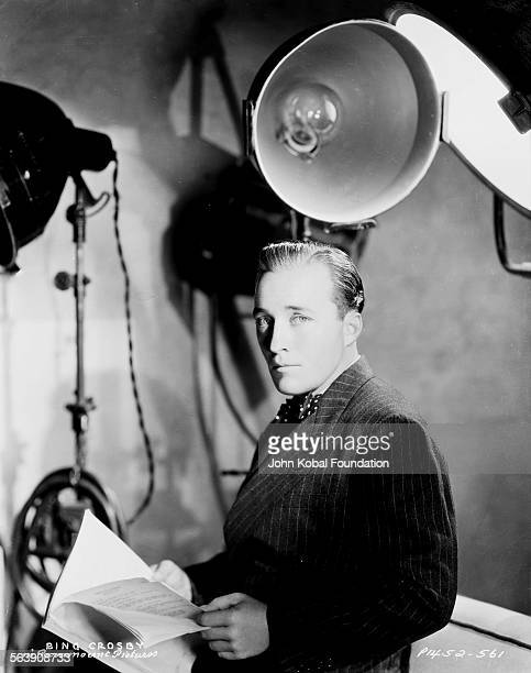 Portrait of actor Bing Crosby reading a script on a film set for Paramount Pictures 1935