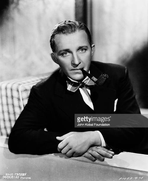 Portrait of actor Bing Crosby smoking a pipe for Paramount Pictures 1936