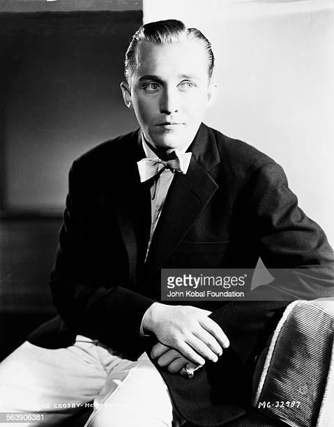 Portrait of actor Bing Crosby wearing a suit and bowtie for MGM Studios 1933