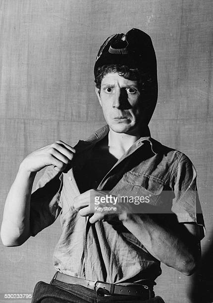 Portrait of actor director and comedian Jonathan Miller wearing a makeshift military uniform during his time at Cambridge University in the...