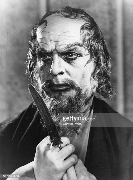 Portrait of actor Emlyn Williams in costume as 'Shylock' as he appears in the play 'The Merchant of Venice' at the Shakespeare Memorial Theatre...