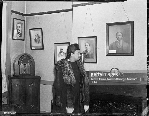 Portrait of actor Frances Williams wearing fox fur stole standing by mantle in Loendi Club Pittsburgh Pennsylvania October 1938