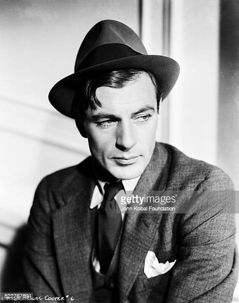 Portrait of actor Gary Cooper wearing a suit and hat, as he appears in the movie 'Mr Deeds Goes to Town', for Frank Capra Productions, 1936.