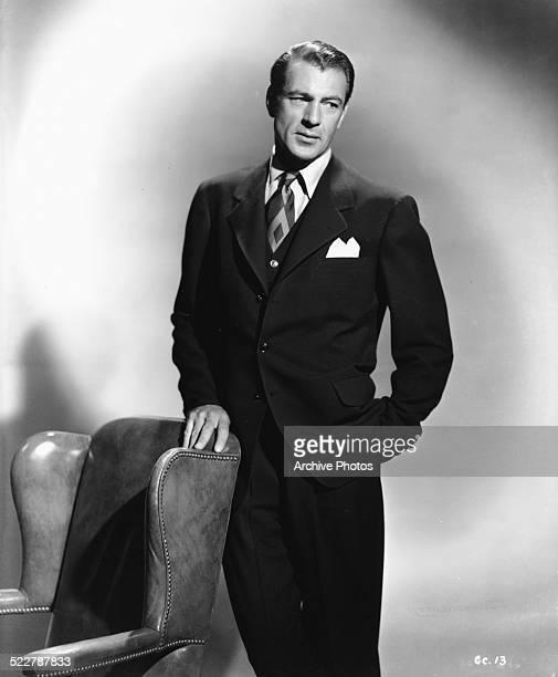 Portrait of actor Gary Cooper, wearing a suit, tie and pocket square, 1942.
