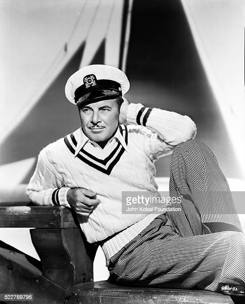 Portrait of actor George Brent wearing a sailor hat and sweater for Warner Brothers Studios 1941
