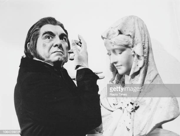 Portrait of actor Geraint Evans with a bust of a woman's head as he appears in the 'Music on 2' television series 'Tales of Hoffmann' March 8th 1970