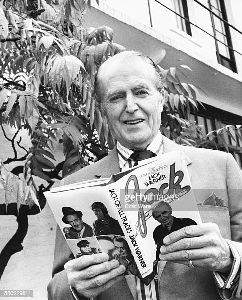 Portrait of actor Jack Warner with his new autobiography 'Jack of all Trades' London circa 1970