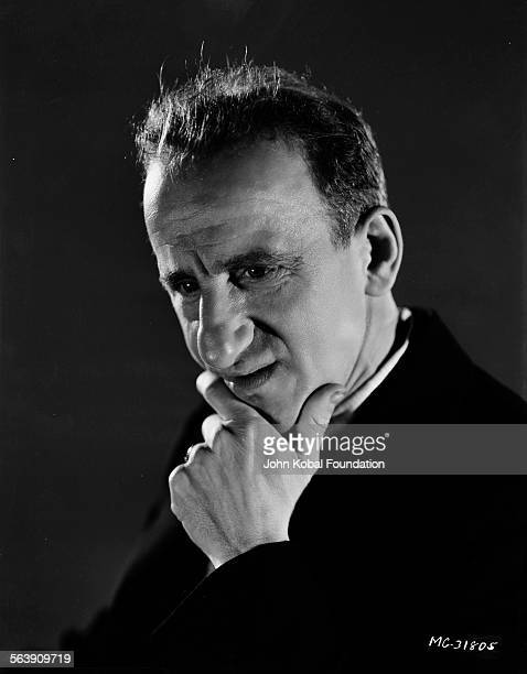 Portrait of actor Jimmy Durante holding his hand to his face for MGM Studios June 28th 1933