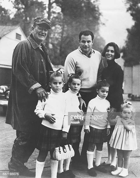 Portrait of actor John Wayne with his son Michael daughterinlaw Gretchen and granddaughters Alicia Maria Teresa and Josephine March 19th 1968