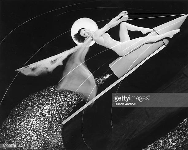 Portrait of actor Kathleen Wilson riding a rocket in a unitard