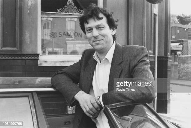 Portrait of actor Leslie Grantham outside 'The Queen Victoria' pub on the set of the television soap opera 'EastEnders' November 21st 1984