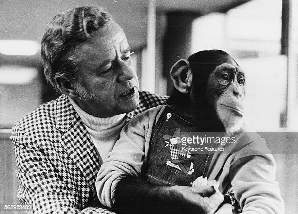 Portrait of actor Marshall Thompson with a trained monkey called Susi as he arrives in Germany to promote his show 'Daktari' at Frankfurt Airport...