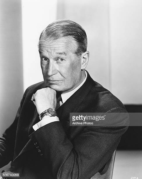 Portrait of actor Maurice Chevalier resting his chin on his hand as he appears in the film 'Gigi' 1958