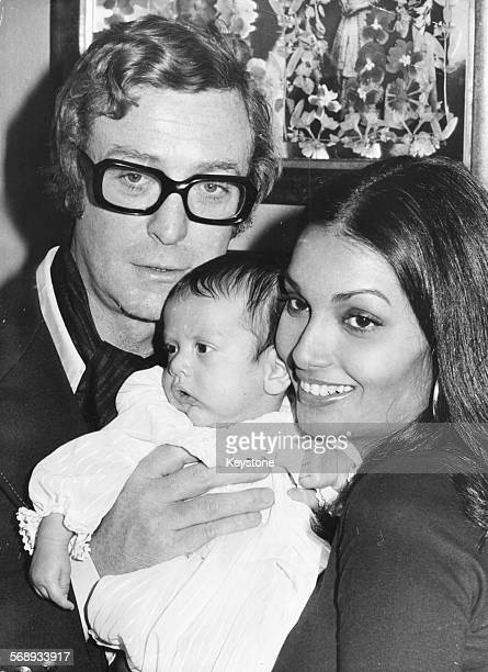 Portrait of actor Michael Caine with his wife Shakira and baby daughter Natasha, London, September 26th 1973.