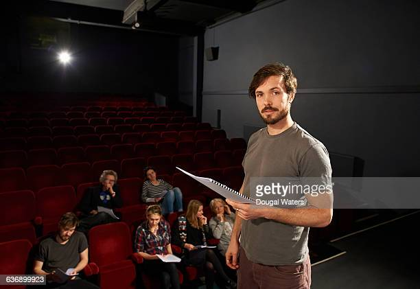 portrait of actor on stage with script. - actor stockfoto's en -beelden